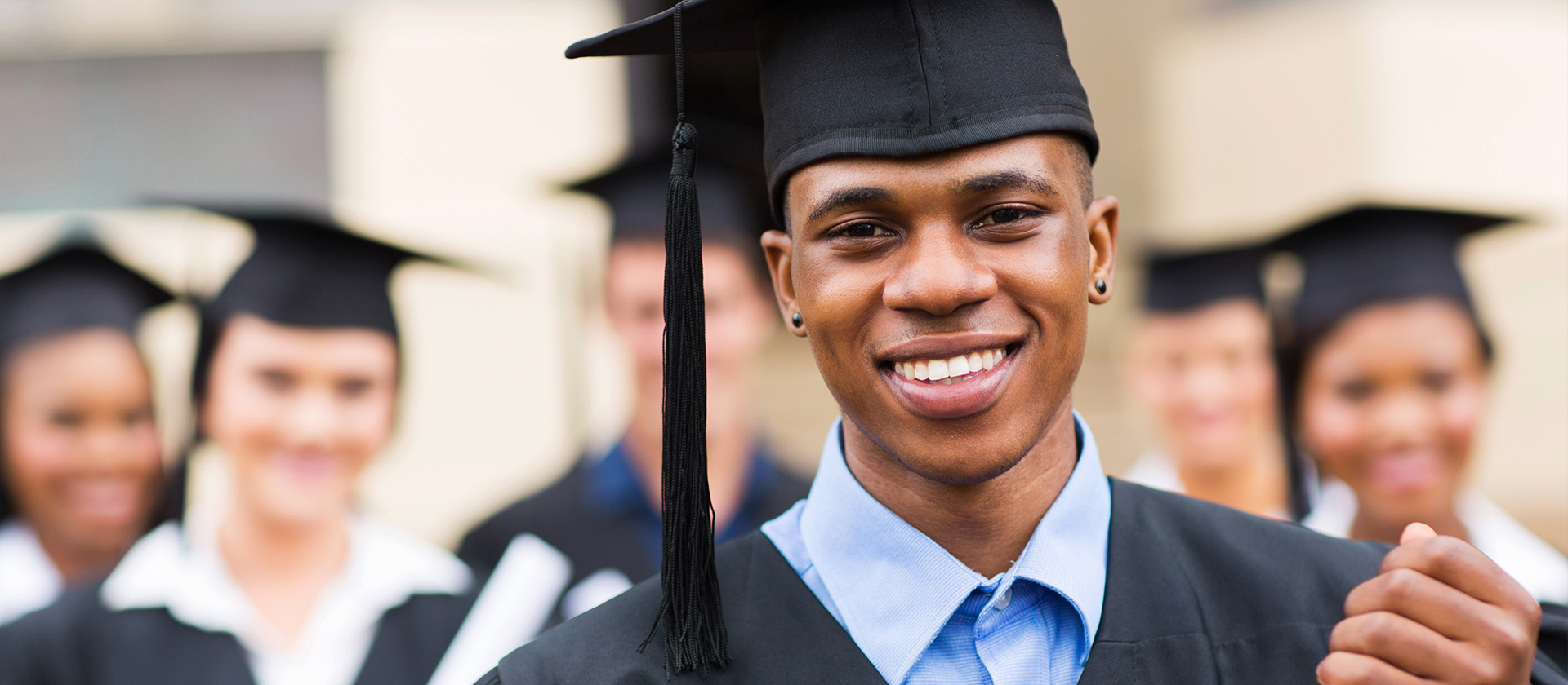 Image of young man in Graduation Cap and Gown